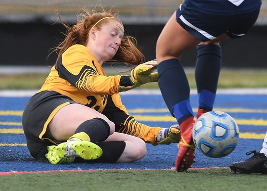 St. John Vianney's Keeper Erica Blackburn makes a great save in the 1st half as St. John Vianney Girls Soccer takes on Toms River North on 10/16/2018