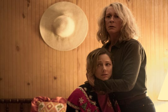 "Laurie Strode (Jamie Lee Curtis) tries to protect her daughter Karen (Judy Greer) in ""Halloween."""