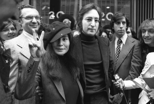 In this April 18, 1972 file photo, John Lennon and his wife, Yoko Ono, leave a U.S. Immigration hearing in New York City.