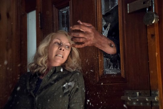 "Laurie Strode (Jamie Lee Curtis) barricades herself inside her home (to no avail) in ""Halloween."""