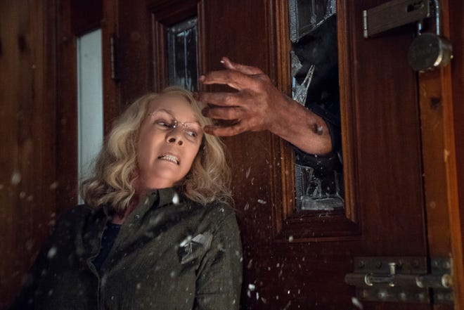 """Laurie Strode (Jamie Lee Curtis) barricades herself inside her home (to no avail) in """"Halloween."""""""