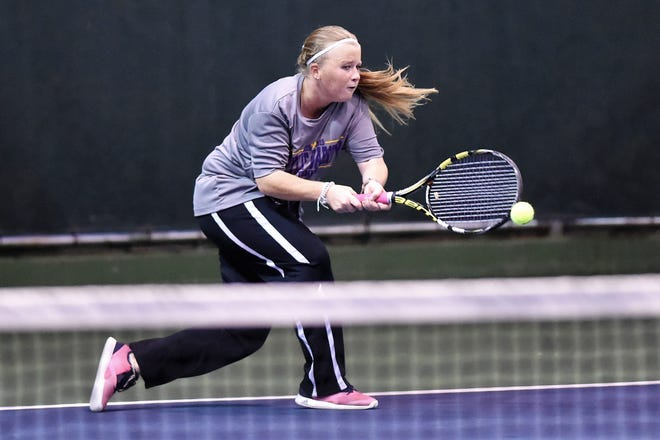 Wylie's Elle Schroeder reaches to hit a backhand shot during her No. 2 girls singles match against Lubbock Monterey in the Region I-5A bi-district playoff on Tuesday, Oct. 16, 2018. Schroeder won her match as the Bulldogs earned the victory.