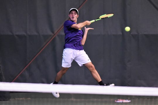 Wylie's Lane Adkins follows through on a shot during his No. 1 boys singles match against Lubbock Monterey in the Region I-5A bi-district playoff on Tuesday, Oct. 16, 2018. Adkins won his match as the Bulldogs earned the victory.