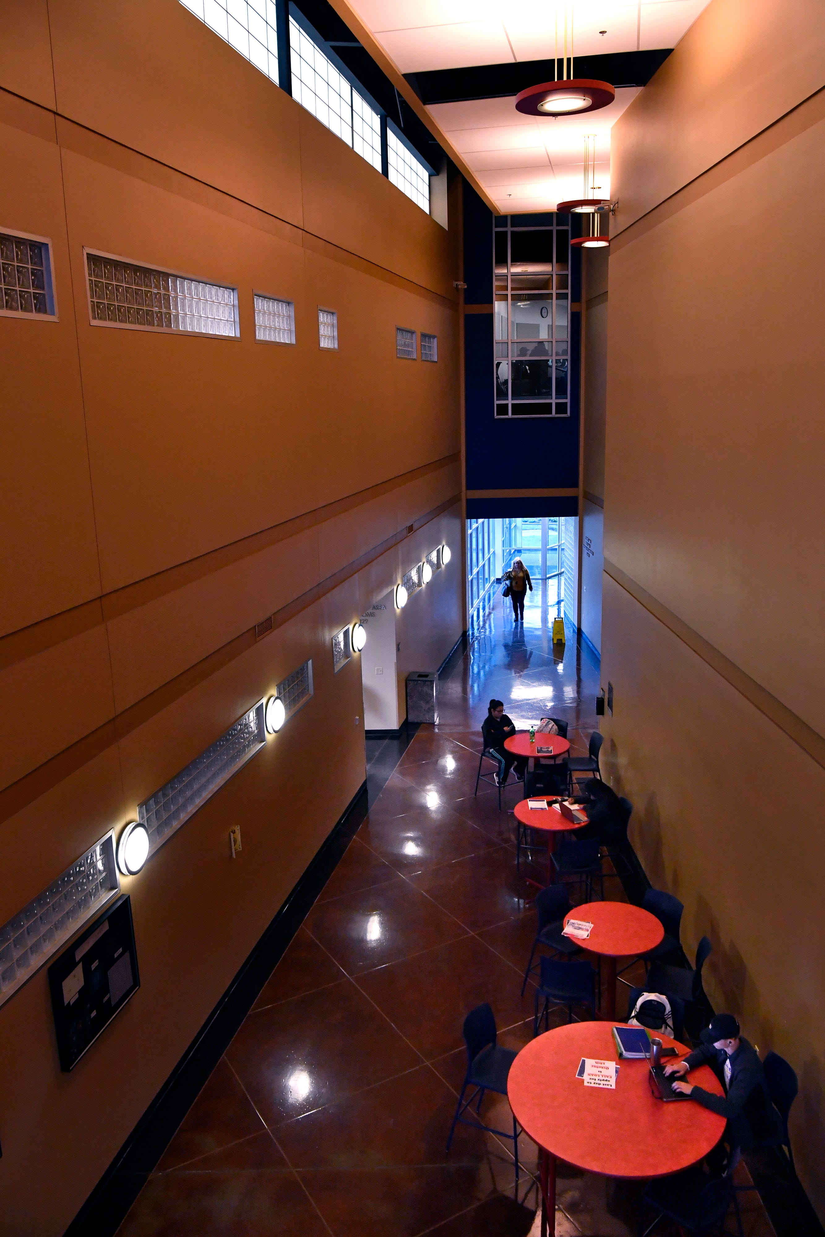 Students study or talk on tables in the lobby at Cisco College in Abilene Tuesday.