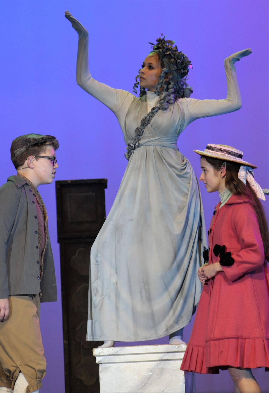 """Micheal (Case Kirby) and Jane Banks (Kyla Sutton) are bored in the park until the statues, including Neleus (Elizabeth Fillingim) come to life in this rehearsal scene from """"Mary Poppins,"""" Wylie High's fall musical."""