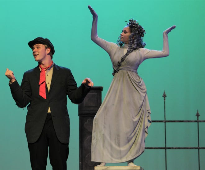 """Bert (Wesley Horn) strikes a pose next to a statue (Elizabeth Fillingim) that has been known to come to life in Wylie High's """"Mary Poppins,"""" which resumes Saturday night and Sunday afternoon at the new Performing Arts Center."""