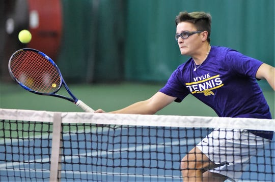 Wylie's Aric Richardson hits a shot at the net during his No. 3 boys doubles match against Lubbock Monterey in the Region I-5A bi-district playoff on Tuesday, Oct. 16, 2018. RicCole Edwards won as the Bulldogs earned the victory.