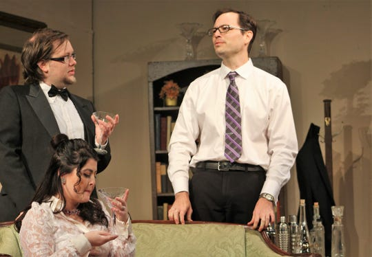 """Dr. George Bradman (Tyler Sparks) and his wife Violet (Eva Luna-Wheeler) enjoy drinks after arriving at the home of novelist Charles Condomine (Matt Maslanka, right) in this rehearsal scene in """"Blithe Spirit,"""" the new Abilene Community Theatre show that starts a two-weekend run Friday."""