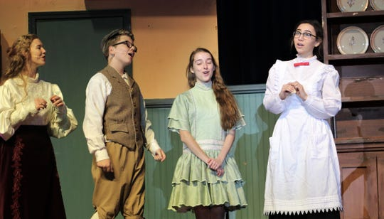 """From left: Mrs. Banks (Kathlyn Messer) joins her children, Michael (Case Kirby) and Jane (Kyla Sutton), and Mary Poppins (Anna Claire Boone) as they sing about the merits of putting a spoonful of sugar in medicine ... you know, to make it go down. Wylie High School presents """"Mary Poppins"""" Thursday, Saturday and Sunday."""