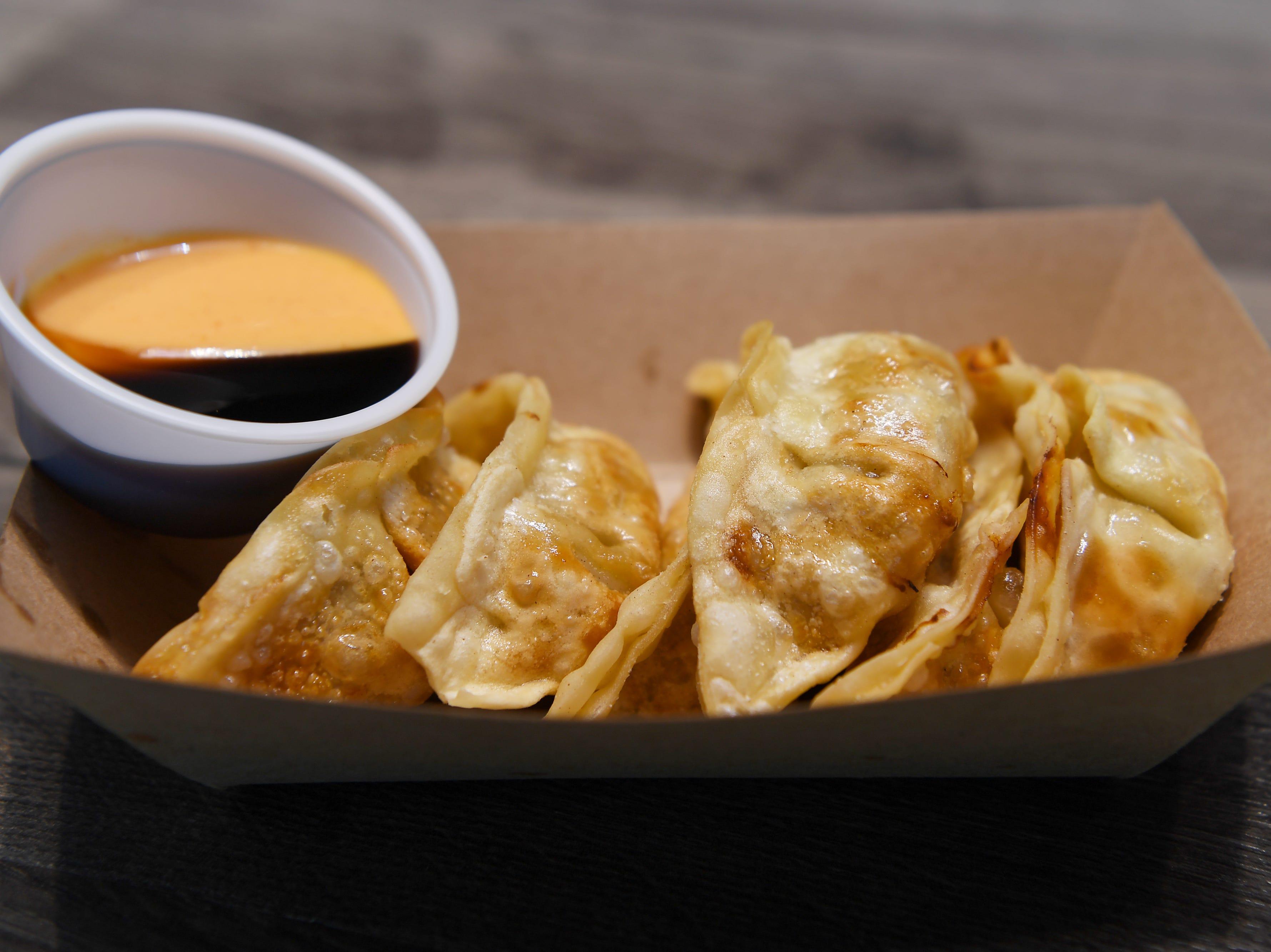 Yum Sushi and Poke's fried pork gyoza are pork dumplings deep fried & served with sriracha aioli.