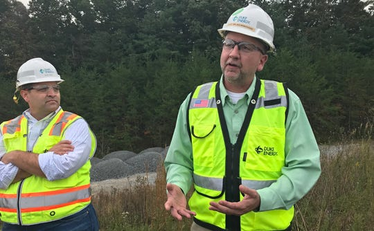 Duke Energy's Jason Walls, left, and Jeff Blackwood, right, discussing the impacts of the company's new combined cycle plant on a tour with members of the news media on Tuesday, Oct. 16. The project is expected to cost $893 million and will replace the company's coal-fired power plant on the property.
