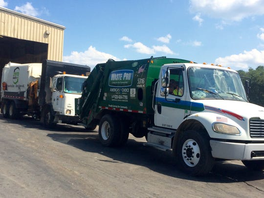 Waste Pro operates a fleet of trucks in Buncombe County, including large rear-loaders like this one and smaller pickup trucks with tippers on the back. That allows the company to provide weekly pickup service to all customers, regardless of geographic location.