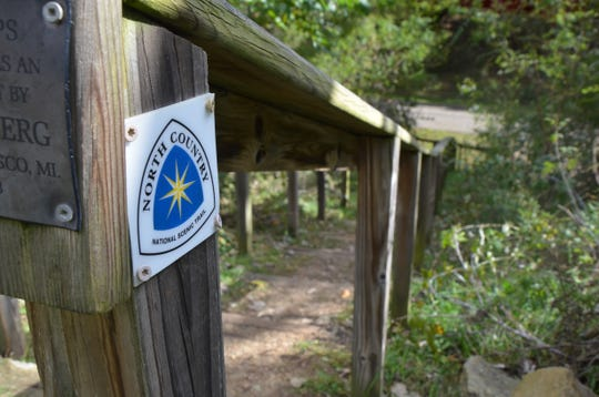 A North Country National Scenic Trail marker on a stairway at Historic Bridge Park on South Wattles Road in Battle Creek.