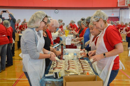 Volunteers at the United Way of the Battle Creek and Kalamazoo Region and Kellogg Co. partnership food-packing event on Oct. 16, 2018, put together meals of rice and beans with vitamins, seasoning and dried vegetables.