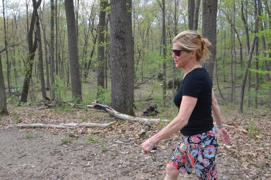 Nancy McFarland of the Calhoun County Trailway Alliance walks the trail at Ott Biological Preserve.