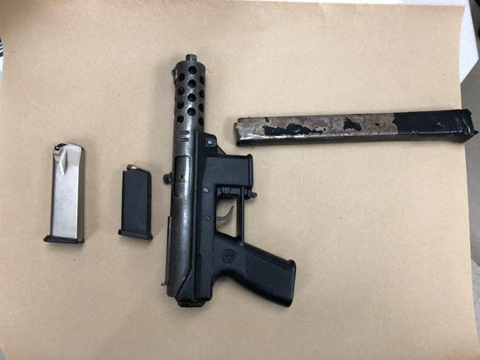 A loaded Tec DC9 pistol was seized when Johnson City police arrested a Pennsylvania fugitive.