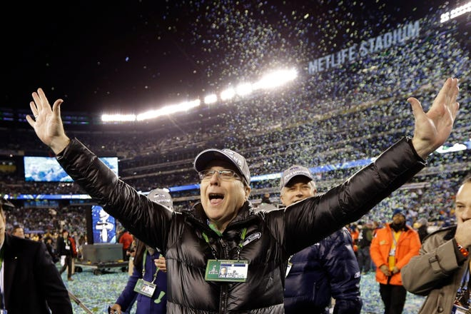 Paul Allen celebrates after the Seahawks won Super Bowl 48.