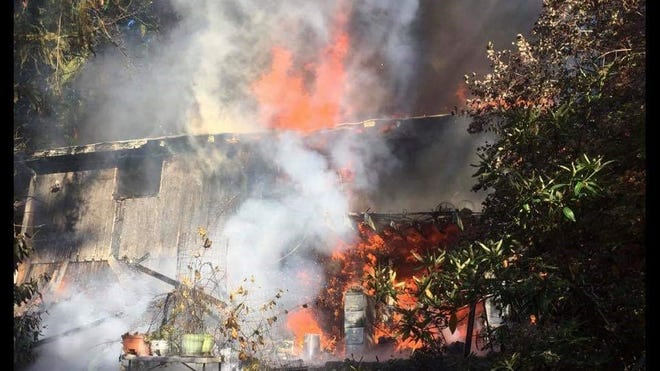 Fire destroyed a home on 11th Avenue in Poulsbo on Monday.