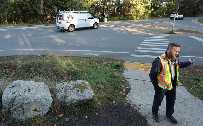 Bainbridge Island city engineer Chris Munter talks about options to improve the intersection of Sportsman Club and New Brooklyn roads.