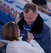 Expedition 57 Flight Engineer Nick Hague of NASA embraces his wife Catie after landing at the Krayniy Airport with Expedition 57 Flight Engineer Alexey Ovchinin of Roscosmos, Thursday, Oct. 11, 2018 in Baikonur, Kazakhstan. Hague and Ovchinin arrived from Zhezkazgan after Russian search-and-rescue teams brought them from the Soyuz landing site. During the Soyuz MS-10 spacecraft's climb to orbit, an anomaly occurred, resulting in an abort downrange. The crew was quickly recovered and is in good condition.