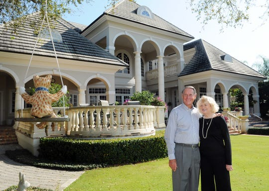 Phil and Jeanne Farmer stand in the backyard of their Indialantic home for a 2013 FLORIDA TODAY feature story.