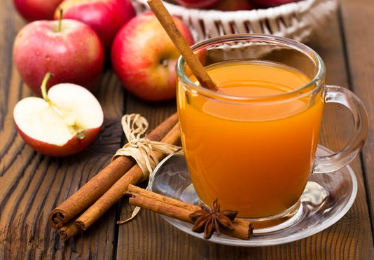 A Cup Of Warm Apple Cider With Cinnamon