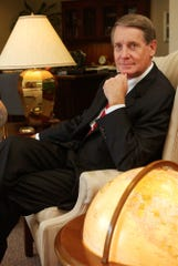 Harris Corp. Chairman, President and Chief Executive Office Phil Farmer sits in his office in 2002.