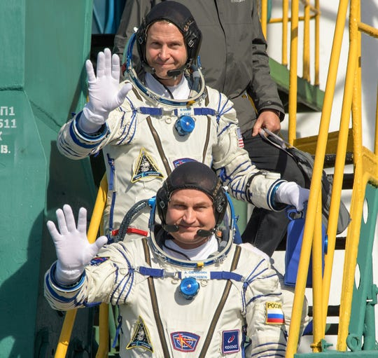 Expedition 57 Flight Engineer Nick Hague of NASA, top, and Flight Engineer Alexey Ovchinin of Roscosmos, wave farewell prior to boarding the Soyuz MS-10 spacecraft for launch, Thursday, Oct. 11, 2018 at the Baikonur Cosmodrome in Kazakhstan.