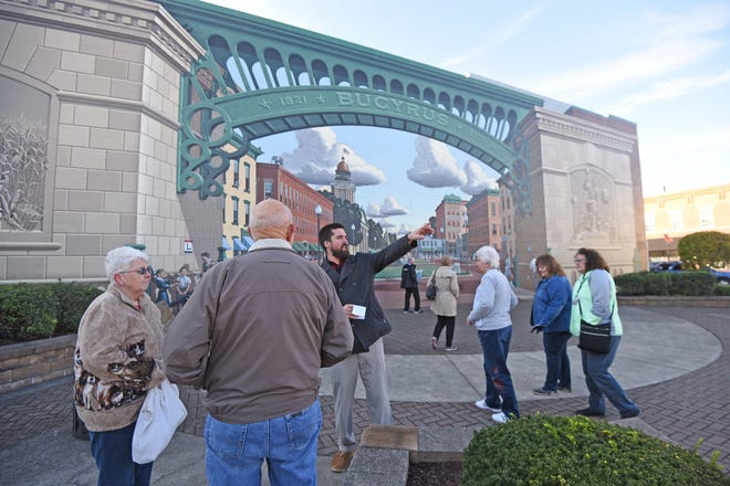 Max Miller gives a group from Madison, Wisconsin, a tour of the city last fall. Miller, who was the bureau's executive director, left his post in May.