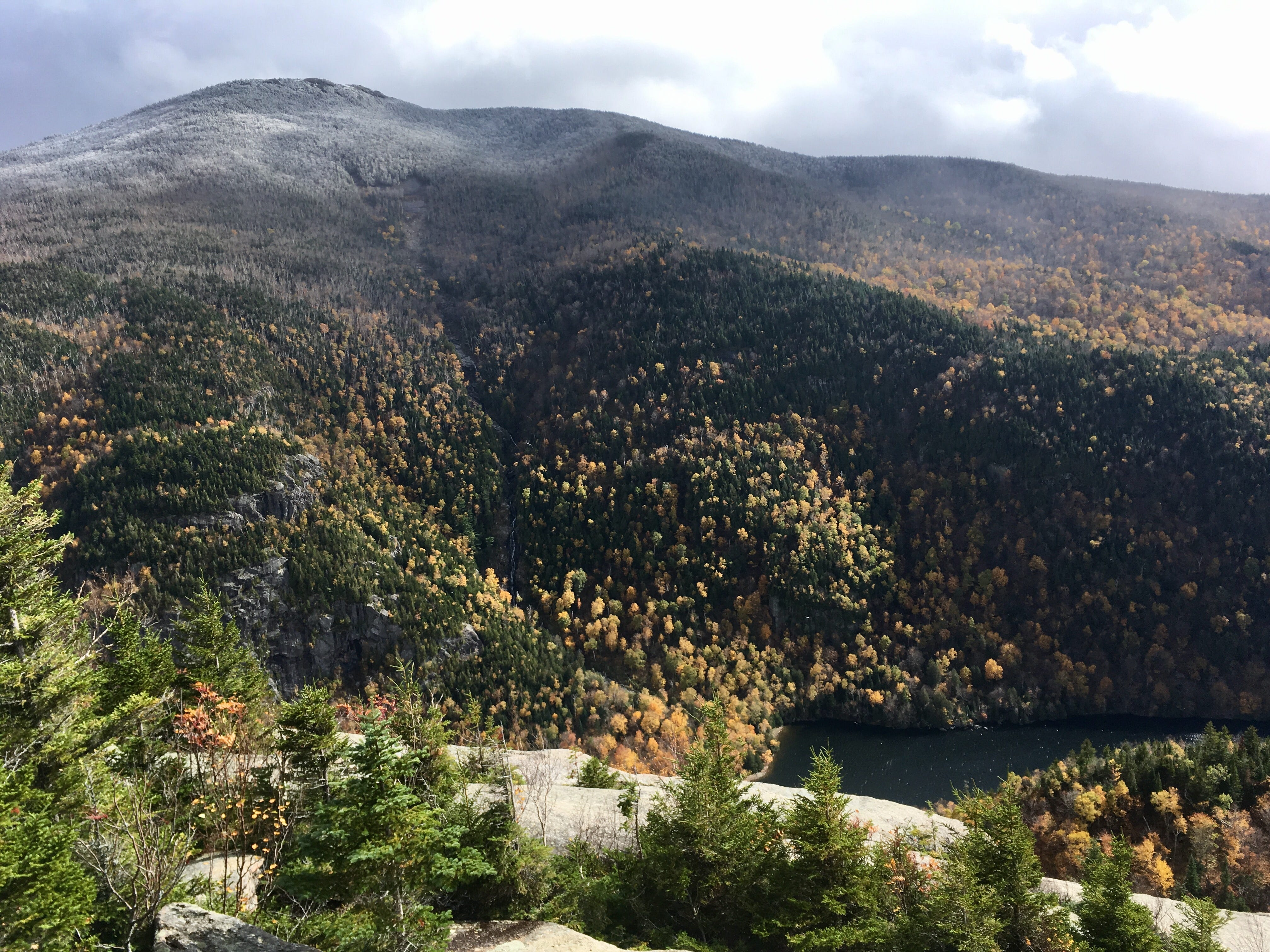 The summit of Cascade Mountain is dusted with snow on Oct. 13, 2018. Seen from the Balanced Rocks on Pitchoff Mountain.