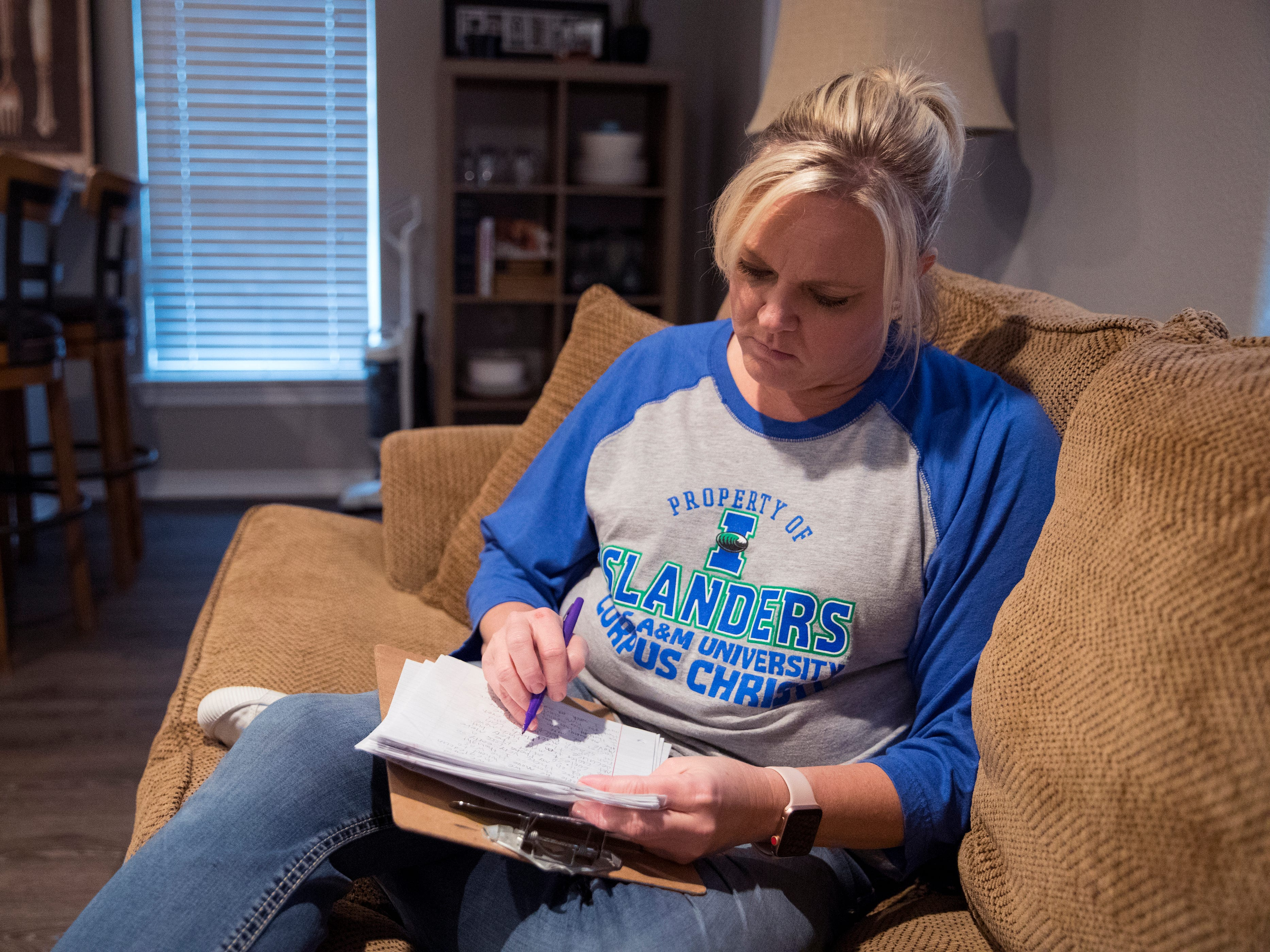 "Christine Kidd McFarland, a fifth-grade teacher at Sinton Elementary School in Sinton, Texas, grades papers at her home on October 8, 2018. She left teaching at one point and took a $30,000 pay cut to return. ""Teaching is a hard job,"" she said. ""And you have to be here for the right reasons."""