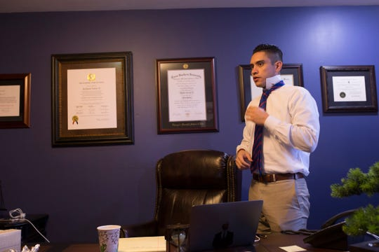 RJ Torres, 30, works in his law office on Wednesday, Oct. 9, 2018 in Corpus Christi. He is one of six candidates running for seats on Corpus Christi City Council who is aged 30 and younger.