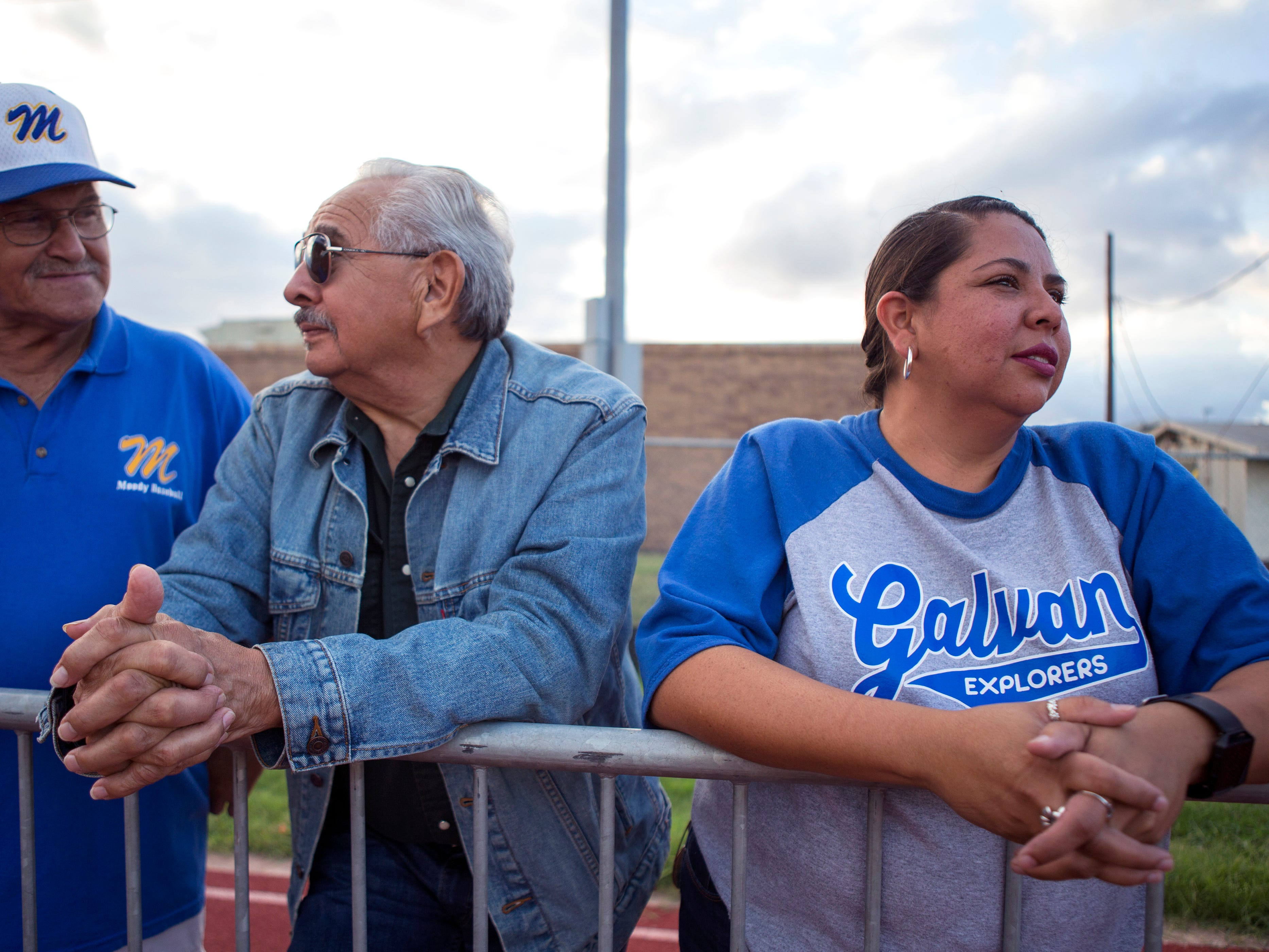 Richard Perales (from left), J.J. Flores and Angel Flores-Cano attend a King High School junior varsity football game at Moody High School on September 27, 2018. A kindergarten teacher at Galvan Elementary School in Corpus Christi, TX, Flores-Cano delivers groceries with Shipt in order to help make ends meet. She averages 12 to 15 hours per week delivering groceries. Texas ranked 28th in the nation for teacher pay for the 2016-17 school year.