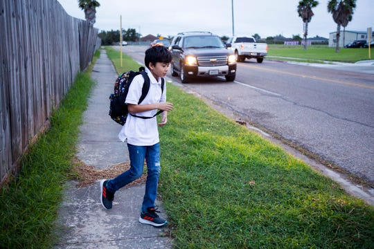 Aiden Garcia, 11, heads to school at at Dawson Elementary School on Tuesday, October 16, 2018. The Coastal Bend will continue to see isolated showers and thunderstorms in the early part of the week and get slightly warmer toward the weekend.