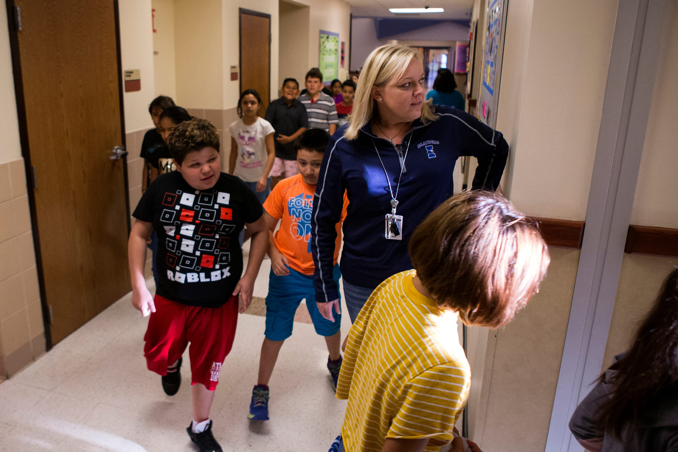 "Christine Kidd McFarland, a fifth-grade teacher at Sinton Elementary School in Sinton, Texas, drops her class off at PE before returning to her class to meet with other fifth grade teachers to plan on Monday, September 17, 2018. ""I wish I had more time to plan lessons that were more engaging for students,"" she said. ""I feel like we work real hard to find good lessons but then we find that we run out of time."""