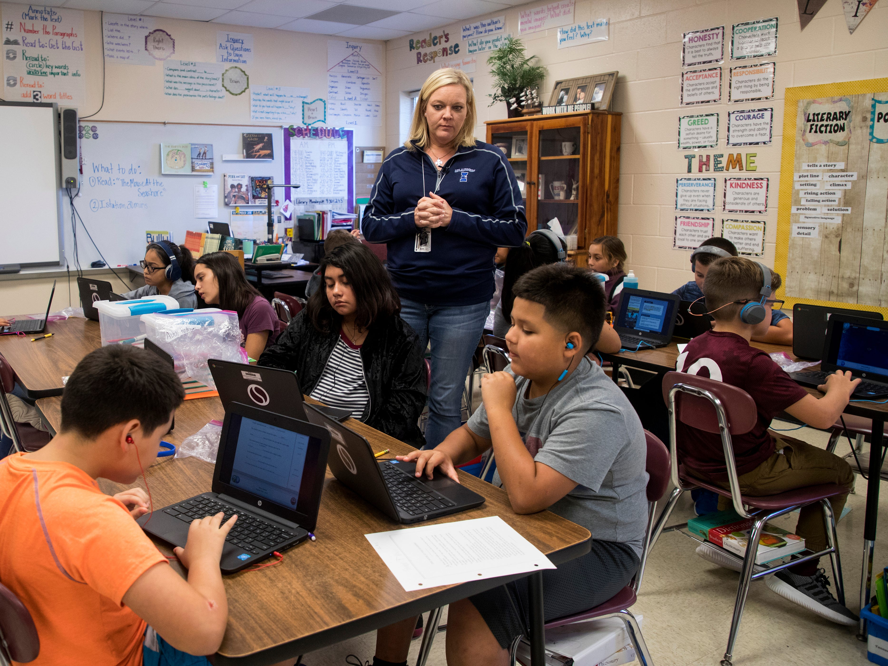 "Christine Kidd McFarland, a fifth-grade teacher at Sinton Elementary School in Sinton, Texas, checks to make sure students are on-task on Monday, September 17, 2018. ""Teaching is a hard job, like I said it's a juggling act,"" she said. ""You are constantly juggling from one subject to the next. To planning, to after-school functions, to individual student needs. And, it's a tough job. And you have to be here for the right reasons."""