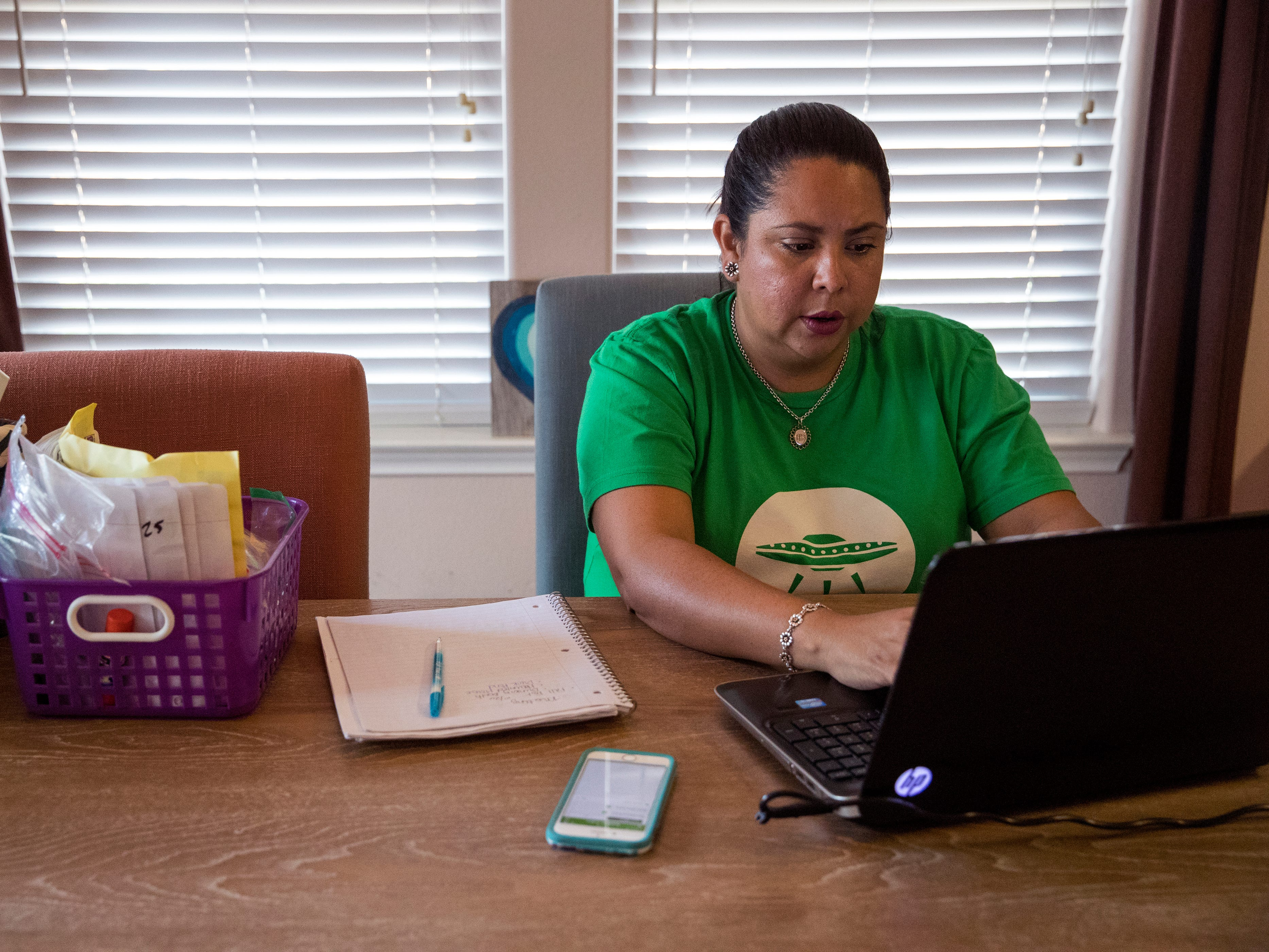 Angel Flores-Cano, a kindergarten teacher at Galvan Elementary School in Corpus Christi, TX, plans for a department meeting while also responding to parent messages at her home on September 26, 2018. The teacher in the Corpus Christi Independent School District delivers groceries with Shipt in order to help make ends meet.