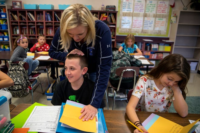 "Christine Kidd McFarland, a fifth-grade teacher at Sinton Elementary School in Sinton, Texas, encourages Oliver White (left), 10, while Callyn McCain, 10, works on a writing project on Monday, September 17, 2018.""In the morning I get up with hopes of making a difference in the lives of a child. Knowing that they're going to come to me and they don't want to be at school most of them, but I want them to know they have a safe place to go with someone who cares about them and wants them to learn, she said."""