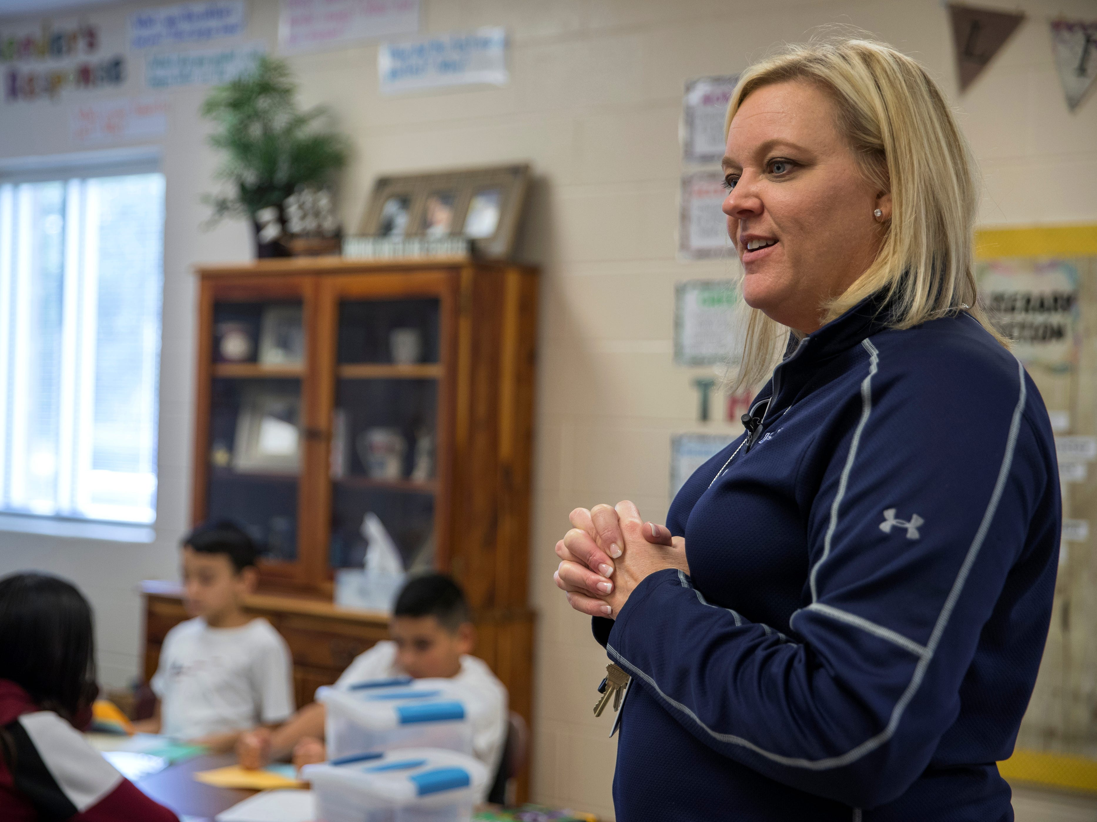 "Christine Kidd McFarland, a fifth-grade teacher at Sinton Elementary School in Sinton, Texas, listens as a student reads her assignment on Monday, September 17, 2018. ""In the morning I get up with hopes of making a difference in the lives of a child. Knowing that they're going to come to me and they don't want to be at school most of them, but I want them to know they have a safe place to go with someone who cares about them and wants them to learn, she said."""