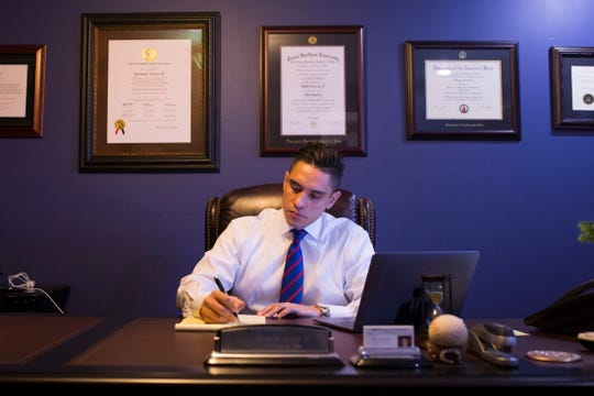 RJ Torres, 30, works in his law office on Wednesday, Oct. 9, 2018 in Corpus Christi. He is one of seven candidates running for seats on Corpus Christi City Council who is aged 30 and younger.