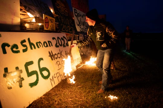 The Rockport-Fulton seniors light their homecoming bonfire at the Rockport Beach Park Pavilion on Monday, Oct. 15, 2018.