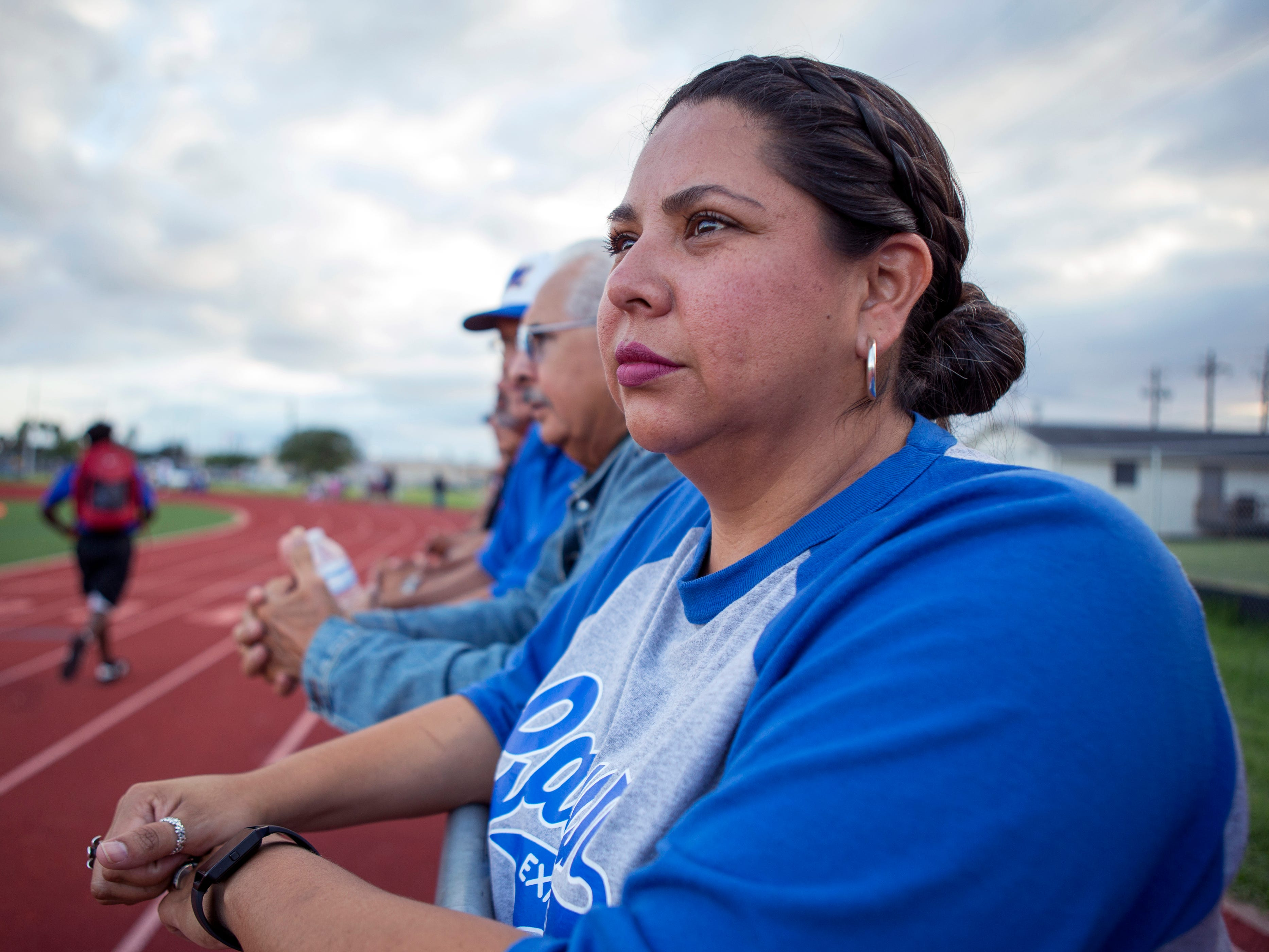 Angel Flores-Cano attends a King High School junior varsity football game at Moody High School on September 27, 2018. A kindergarten teacher at Galvan Elementary School in Corpus Christi, TX, Flores-Cano delivers groceries with Shipt in order to help make ends meet. She averages 12 to 15 hours per week delivering groceries. Texas ranked 28th in the nation for teacher pay for the 2016-17 school year.