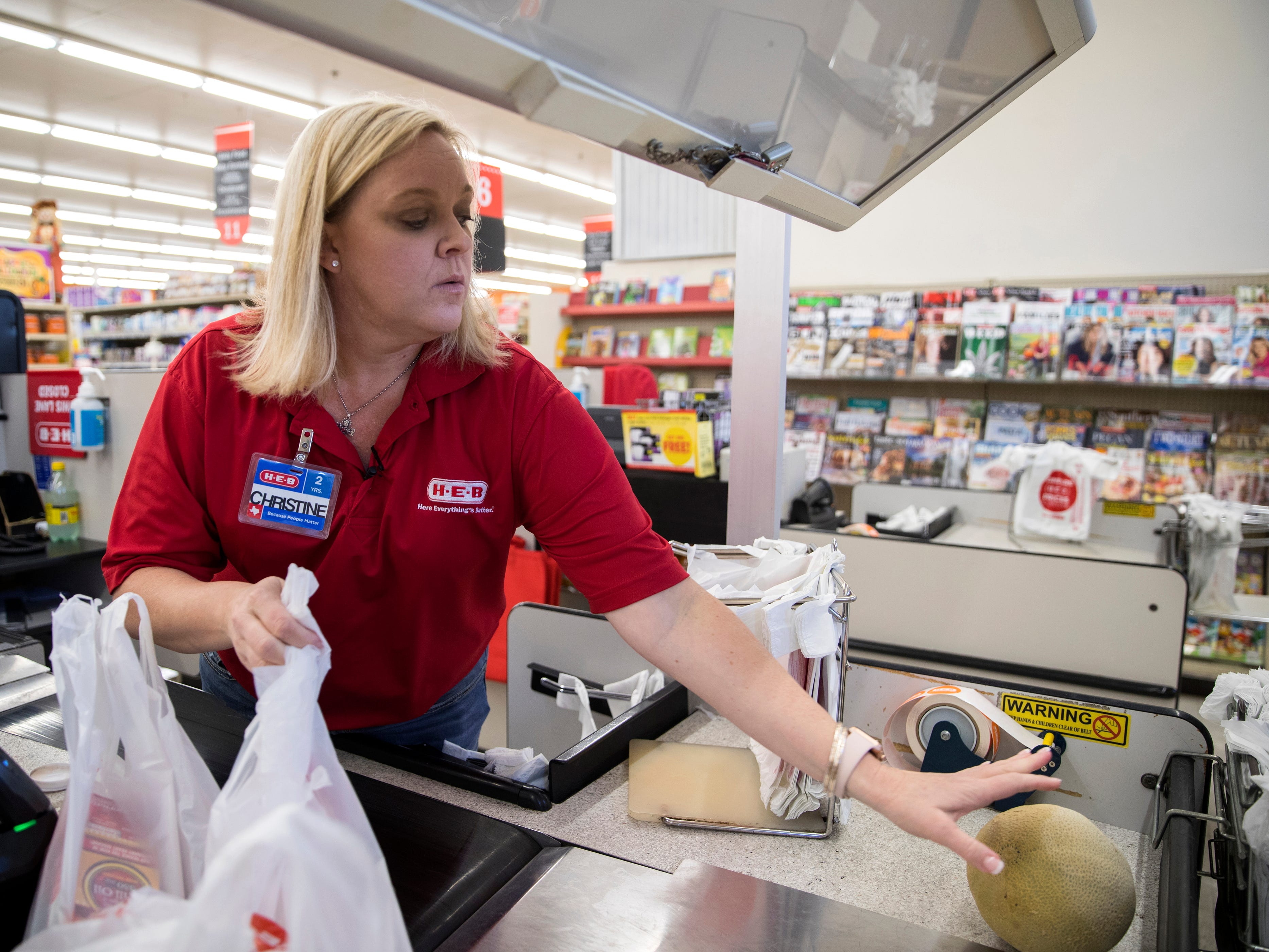 "Christine Kidd McFarland, a fifth-grade teacher at Sinton Elementary School in Sinton, Texas, rubs her neck as she waits for a customer to check out at H-E-B, a grocery store, on Monday, September 17, 2018. ""Almost every single teacher that I know has some kind of a side gig,"" she said. ""They either sell some kind of product out of their home, or babysit on the side, keep kids after school, or work on the weekends. If it's a single teacher, they just cannot make it on the income that we're afforded."""