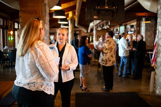 Kaylynn Paxson (right) greets people at the Padre Island Business Association luncheon on Thursday , Oct. 11, 2018. At 28, she is one of six candidates running for Corpus Christi City Council who are aged 30 and under.