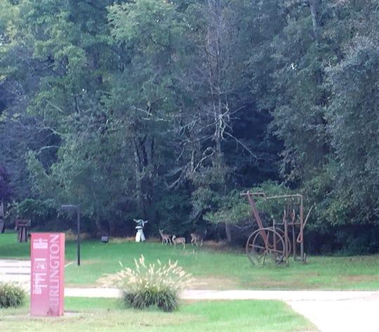 Deer graze in a sculpture garden at the former campus of Rowan College at Burlington County in Pemberton Township.