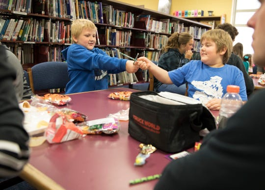 Chad Elliott, left, and Jesse May pencil fight after getting a goody bag at the Big Brothers, Big Sisters Halloween themed party at Southeastern High School Tuesday Morning in Chillicothe.