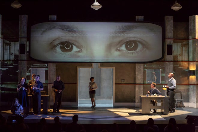 """The cast of Cincinnati Shakespeare Company's stage adaptation of George Orwell's """"1984"""" is seen in the midst of an ominous visual environment created by Brave Berlin, the Cincinnati company best-known as the creators of Lumenocity and Blink."""
