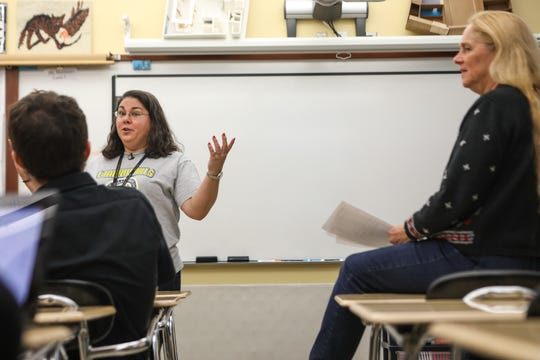 Laura Wasem, a Latin teacher at Walnut Hills high school in Cincinnati, Ohio, leads a discussion with her department. They talk about tests and best practices to prepare their students while maintaining education guidelines.