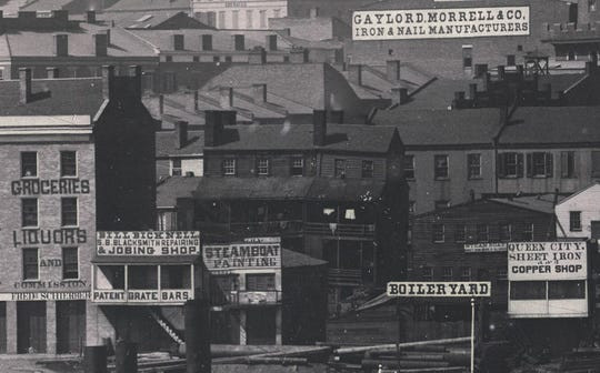 Many of the stores, shops and bars that catered to the steamboat traffic can be seen in this close-up shot from Plate 3 of the panorama. Provided.