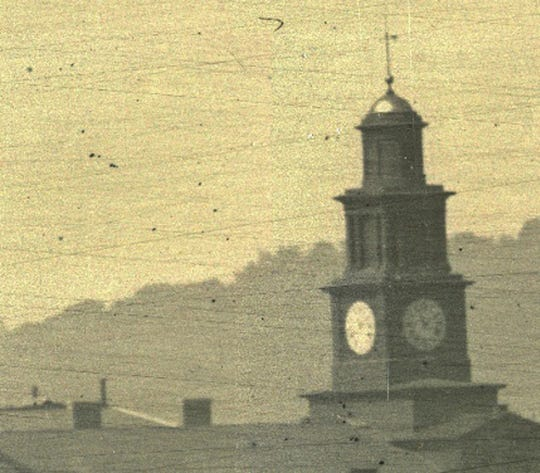 This high-resolution zoom shot of the Second Presbyterian Church's clock tower clearly reveals the time as 1:55 p.m. Until this zoom image was created recently with high-tech microscopes, no one knew exactly when the famous panorama shots of Cincinnati's riverfront were taken. Historians had narrowed it down to early afternoon, Sept. 24, 1848.
